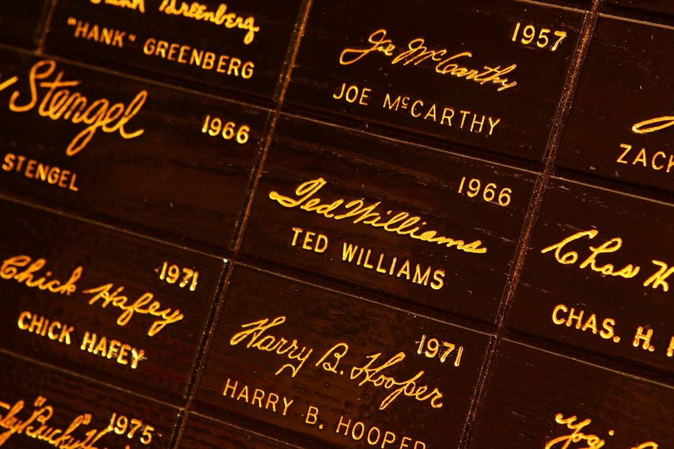 Photo - This undated image released by the Louisville Slugger Museum & Factory shows the signature of Boston red Sox player Ted Williams, center, on the signature wall at the museum in Louisville, Ky. Visitors can trace that baseball heritage along the Louisville Slugger Walk of Fame, stretching about a mile from the Louisville Slugger Museum & Factory to the city's minor-league ballpark. (AP Photo/H&B, James Moses)