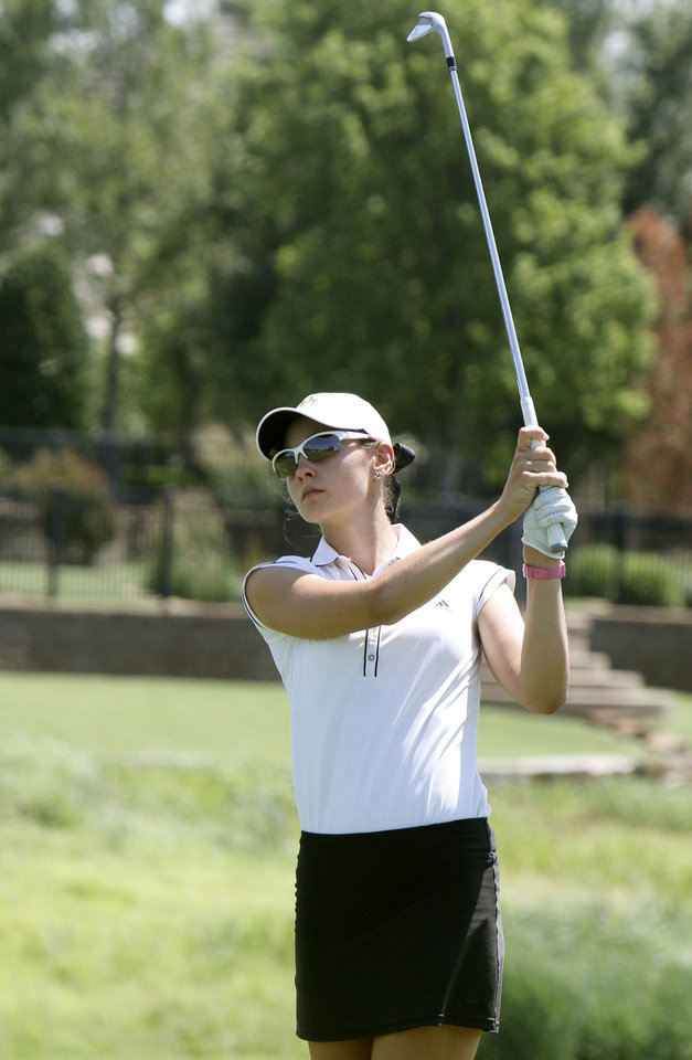 Photo - Maggie Beth Byers swings from the fairway during the match play semifinals of the WSGA championship at Gaillardia Country Club in Oklahoma City, OK, Thursday, June 5, 2014,  Photo by Paul Hellstern, The Oklahoman