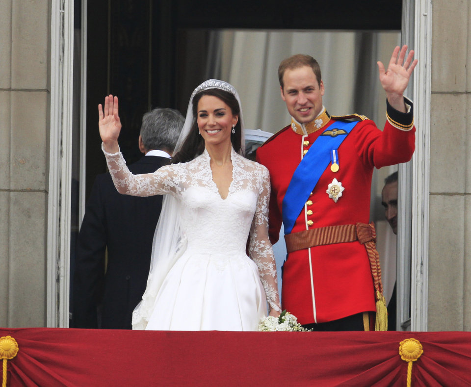 Photo - Britain's Prince William and his wife Kate, Duchess of Cambridge wave from the balcony of Buckingham Palace after the Royal Wedding in London Friday, April, 29, 2011. (AP Photo/Matt Dunham) ORG XMIT: RWMG182