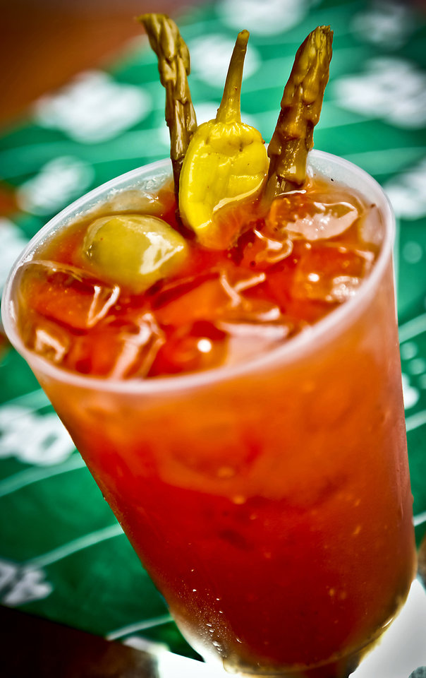 Photo - Bloody Mary for a tailgate cookout. Photo by Chris Landsberger, The Oklahoman  CHRIS LANDSBERGER - CHRIS LANDSBERGER
