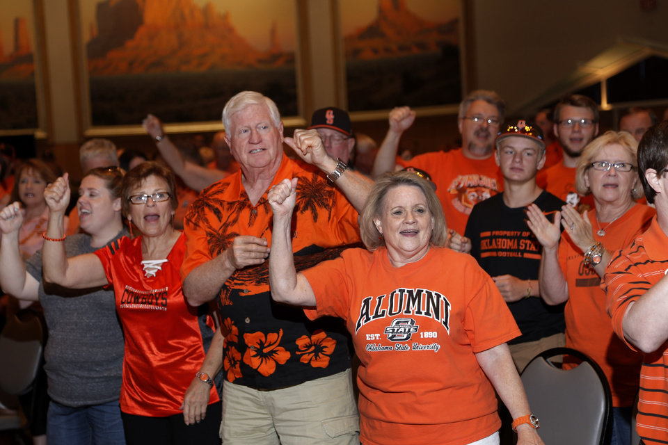Photo - OSU fans sing along to the fight song during the OSU Cowboy Caravan at the National Cowboy and Western Heritage Museum Tuesday, August 5, 2014. Photo by Doug Hoke, The Oklahoman