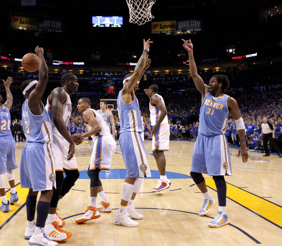 Photo - Oklahoma City's Kendrick Perkins (5) stands between Ty Lawson (3), Kenyon Martin (4), and Nene (31) after a disputed call in the final minutes of the NBA basketball game between the Denver Nuggets and the Oklahoma City Thunder in the first round of the NBA playoffs at the Oklahoma City Arena, Sunday, April 17, 2011. Photo by Bryan Terry, The Oklahoman ORG XMIT: KOD