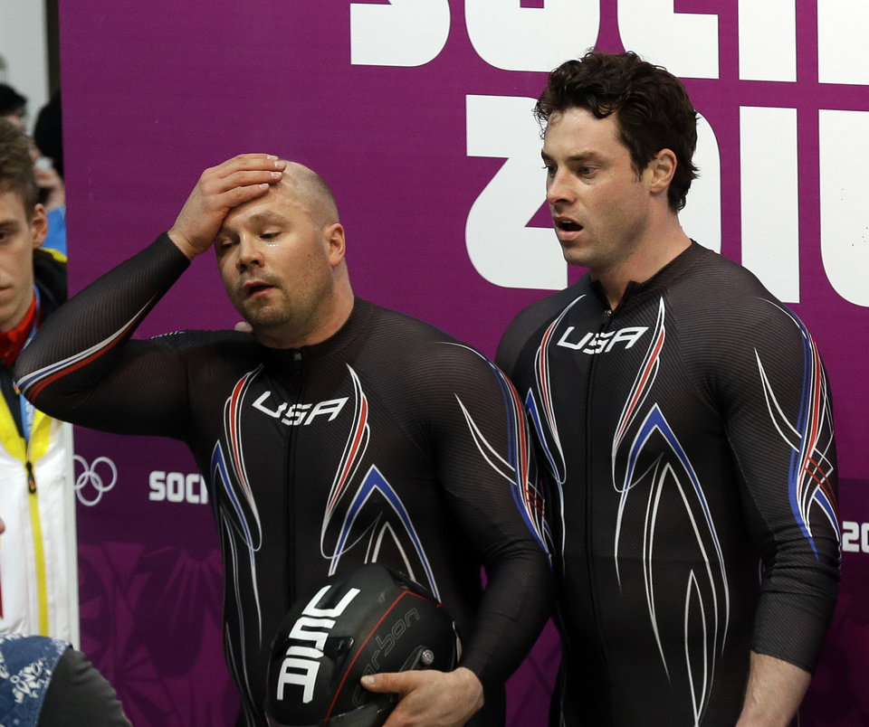 Photo - The team from the United States USA-1, piloted by Steven Holcomb and brakeman Steven Langton, react after their bronze medal finish during the men's two-man bobsled competition at the 2014 Winter Olympics, Monday, Feb. 17, 2014, in Krasnaya Polyana, Russia. (AP Photo/Natacha Pisarenko)