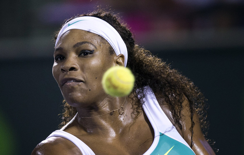 Photo - Serena Williams returns the ball to Ayumi Morita, of Japan, during the Sony Open tennis tournament, Saturday, March 23, 2013, in Key Biscayne, Fla. (AP Photo/J Pat Carter)