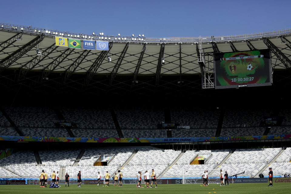 Photo - The Belgium national soccer squad train at the Mineirao Stadium in Belo Horizonte, Brazil, Monday, June 16, 2014. Belgium will play in group H of the Brazil 2014 soccer World Cup.  (AP Photo/Bruno Magalhaes)