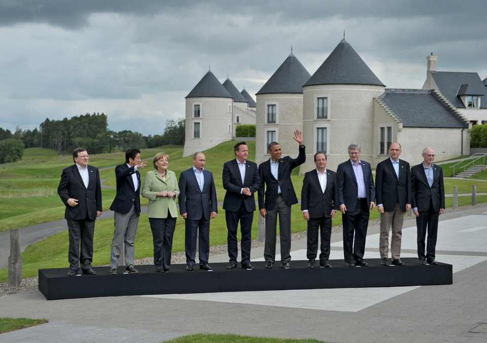 Photo - G-8 leaders from left, European Commission President Jose Manuel Barroso, Japan's Prime Minister Shinzo Abe, German Chancellor Angela Merkel, British Prime Minister David Cameron, US President Barack Obama, Russian President Vladimir Putin, French President Francois Hollande, Canadian Prime Minister Stephen Harper, Italian Prime Minister Enrico Letta and European Council President Herman Van Rompuy walk to a group photo opportunity during the G-8 summit at the Lough Erne golf resort in Enniskillen, Northern Ireland, on Tuesday, June 18, 2013. The final day of the G-8 summit of wealthy nations is ending with discussions on globe-trotting corporate tax dodgers, a lunch with leaders from Africa, and suspense over whether Russia and Western leaders can avoid diplomatic fireworks over their deadlock on Syria?s civil war. (AP Photo/RIA-Novosti, Alexei Nikolsky, Presidential Press Service)