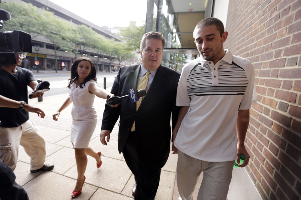 Photo -   Kenneth W. Smith Jr., right, accompanied by his lawyer Bill Brennan walks near the U.S. Courthouse, Friday, Sept. 7, 2012, in Philadelphia. Smith was arrested and is charged with making a hoax threat that led authorities to recall a plane in midair to the Philadelphia airport. Federal authorities charged 26-year-old Smith Jr. with conveying false and misleading information. According to a criminal complaint, Smith called police at the airport on Thursday, Sept. 6, 2012 and falsely reported a passenger was carrying an explosive substance. Authorities then recalled a Dallas-bound US Airways flight to Philadelphia. (AP Photo/Matt Rourke)