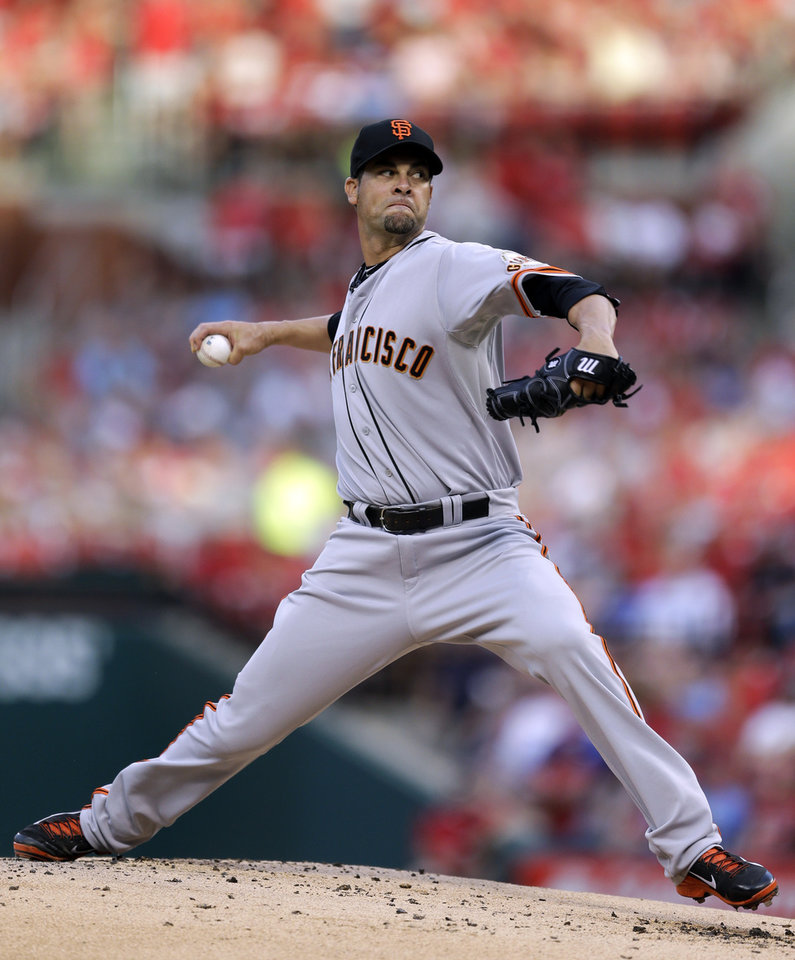 Photo - San Francisco Giants starting pitcher Ryan Vogelsong throws during the first inning of a baseball game against the St. Louis Cardinals, Thursday, May 29, 2014, in St. Louis. (AP Photo/Jeff Roberson)