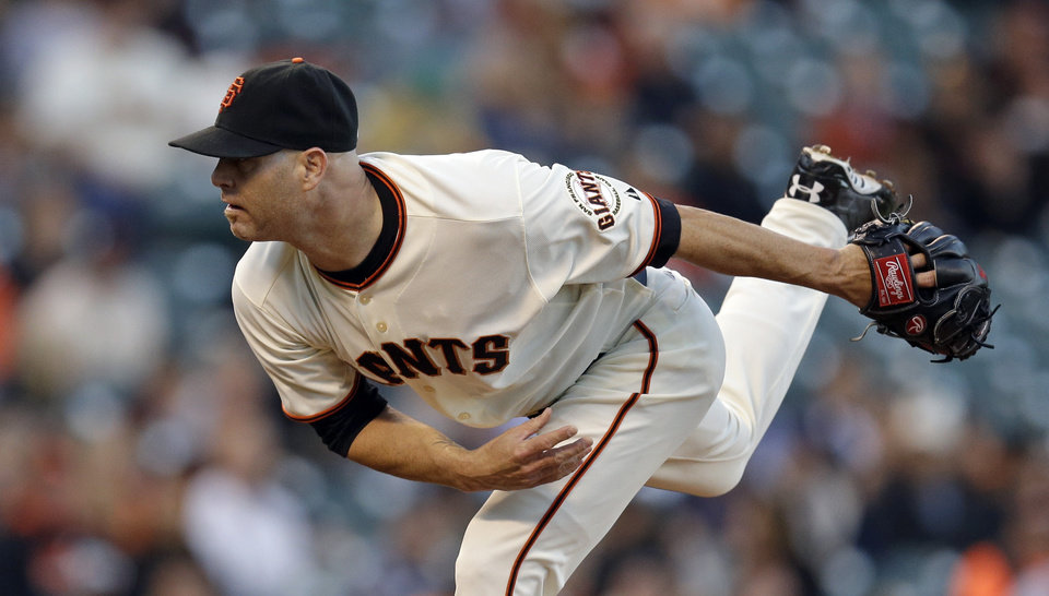 Photo - San Francisco Giants' Tim Hudson follows through on a delivery to the Colorado Rockies in the first inning of a baseball game Wednesday, Aug. 27, 2014, in San Francisco. (AP Photo/Ben Margot)