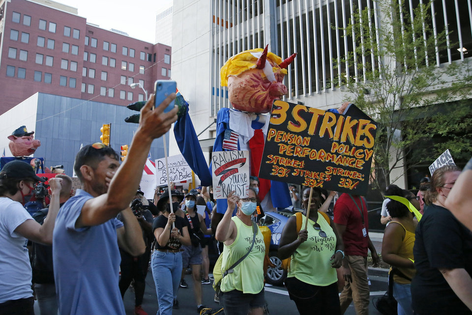 Photo - Protesters march in downtown Tulsa during a President Donald Trump rally at the BOK Center in Tulsa, Okla., Saturday, June 20, 2020. [Bryan Terry/The Oklahoman]