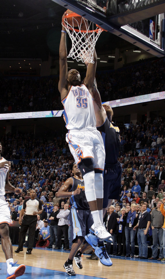 Photo - Oklahoma City's Kevin Durant (35) ties the game with a dunk as Denver's Chris Andersen (11) defends during the NBA basketball game between the Oklahoma City Thunder and the Denver Nuggets at the Chesapeake Energy Arena, Sunday, Feb. 19, 2012. Photo by Sarah Phipps, The Oklahoman