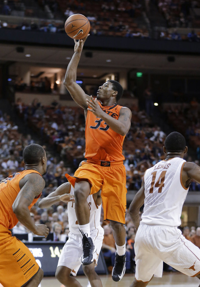 Oklahoma State\'s Marcus Smart (33) shoots against Texas during the second half of an NCAA college basketball game, Saturday, Feb. 9, 2013, in Austin, Texas. Oklahoma State won 72-59. (AP Photo/Eric Gay) ORG XMIT: TXEG108