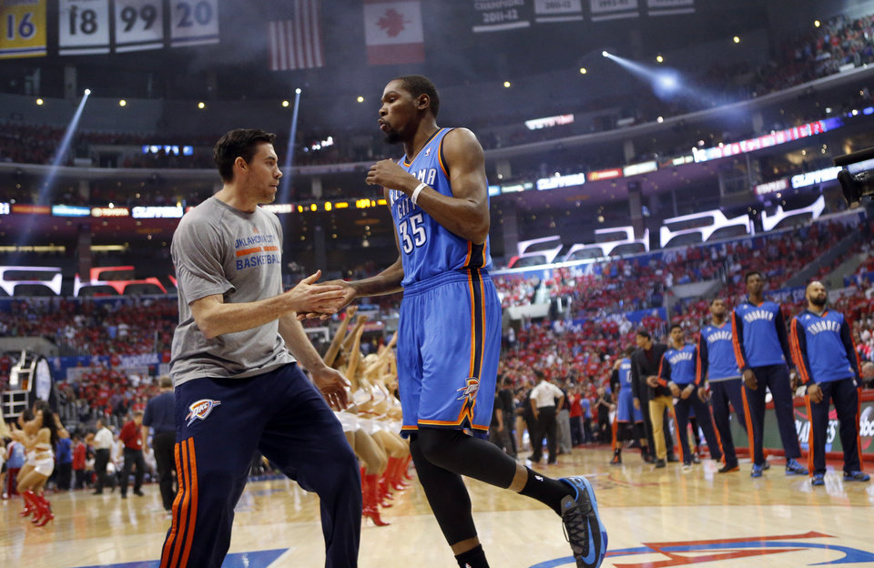 Photo - Oklahoma City's Nick Collison (4) and Kevin Durant (35) get ready for Game 6 of the Western Conference semifinals in the NBA playoffs between the Oklahoma City Thunder and the Los Angeles Clippers at the Staples Center in Los Angeles, Thursday, May 15, 2014. Photo by Nate Billings, The Oklahoman