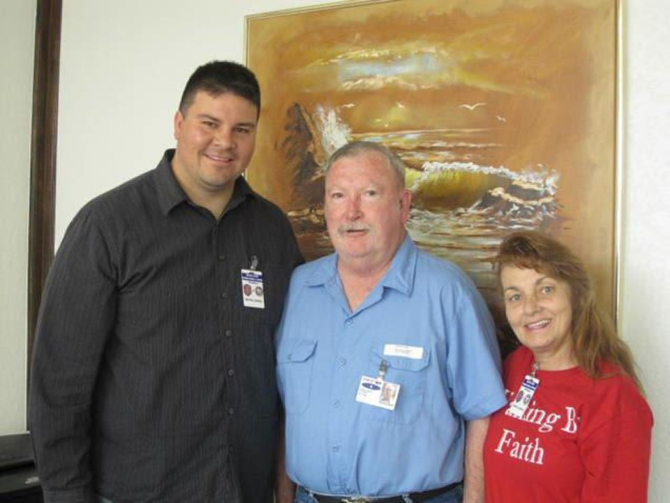 Former pharmacist Jerome Jay Ersland, center, poses Friday in prison with two supporters, state Sen. Ralph Shortey and Karen Monahan. <strong>PHOTO PROVIDED</strong>