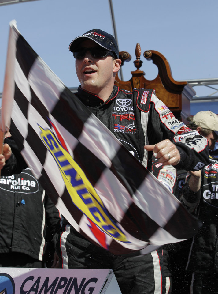 Photo - Driver Johnny Sauter (98) celebrates winning the Kroger 250 NASCAR Truck series auto race at Martinsville Speedway in Martinsville, Va., Saturday, April 6, 2013.  (AP Photo/Steve Helber)