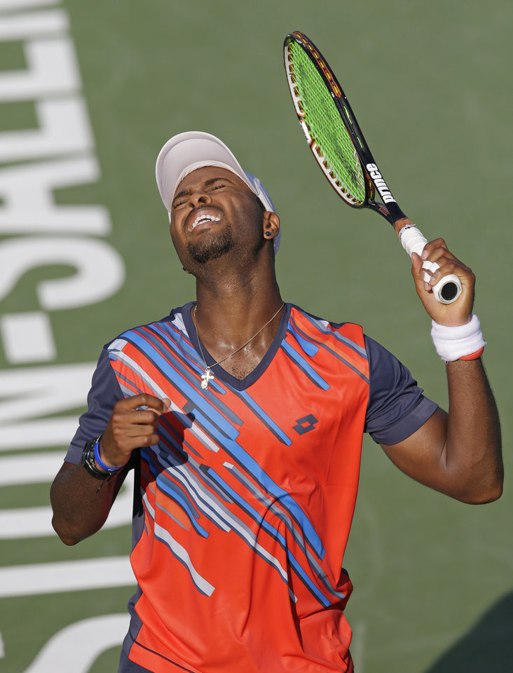 Photo - Donald Young, of the United States, reacts after missing a shot against Guillermo Garcia-Lopez, of Spain, at the Winston-Salem Open tennis tournament in Winston-Salem, N.C., Wednesday, Aug. 20, 2014. Garcia-Lopez won 6-7 (4), 6-3, 7-6 (6). (AP Photo/Chuck Burton)