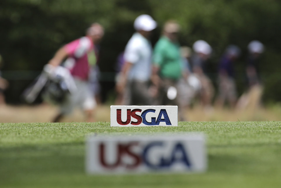 Photo - Miguel Angel Jimenez, of Spain, walks on the second hole during a practice round for the U.S. Open golf tournament in Pinehurst, N.C., Wednesday, June 11, 2014. The tournament starts Thursday. (AP Photo/Eric Gay)