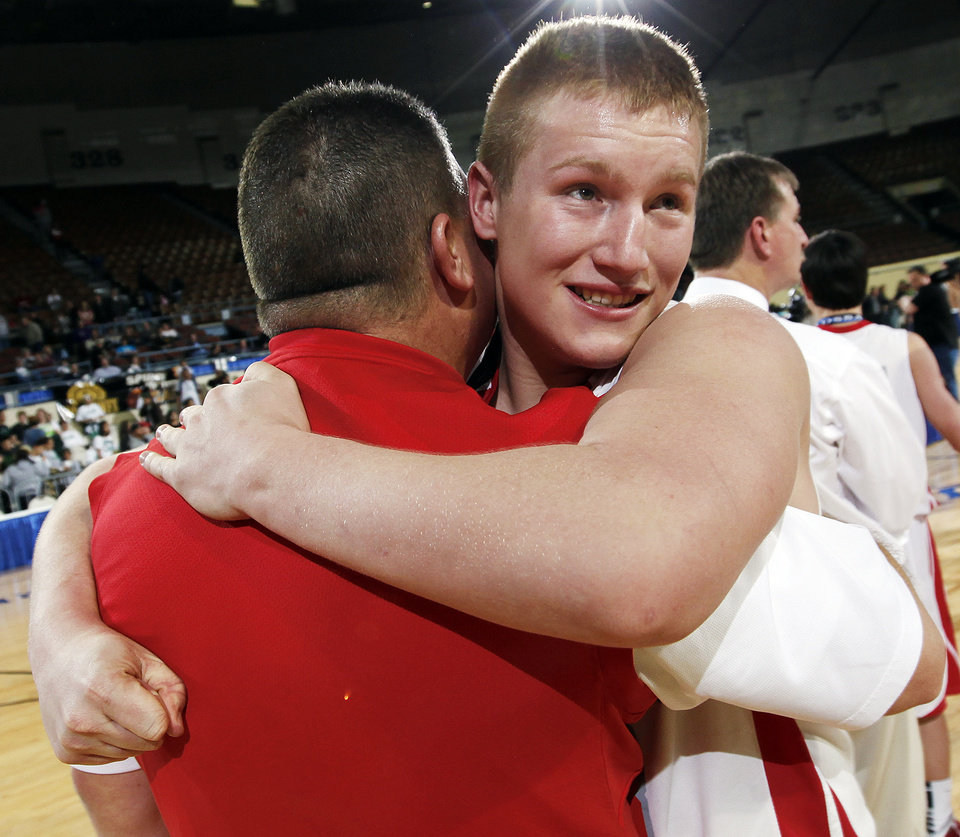 Forgan\'s Tayler Eagan (23) hugs head coach Todd Kerr after the Class B boys basketball state tournament championship game between Graham and Forgan at State Fair Arena in Oklahoma City, Saturday, March 5, 2011. Forgan won, 81-47. Photo by Nate Billings, The Oklahoman