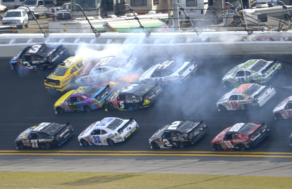 Michael Annett (43), Johanna Long (70), Travis Pastrana (60), Hal Martin (44) and Kasey Kahne (5) collide between Turns 1 and 2 during the NASCAR Nationwide Series auto race at Daytona International Speedway in Daytona Beach, Fla., Saturday, Feb. 23, 2013. (AP Photo/Phelan M. Ebenhack)