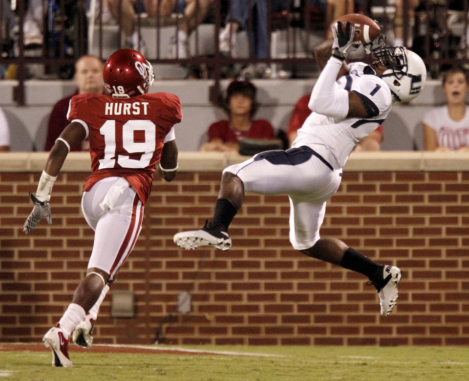Photo - Utah State's Xavier Martin catches a touchdown pass in front of OU's Demontre Hurst during the second half of the college football game between the University of Oklahoma Sooners (OU) and Utah State University Aggies (USU) at the Gaylord Family-Oklahoma Memorial Stadium on Saturday, Sept. 4, 2010, in Norman, Okla.   Photo by Bryan Terry, The Oklahoman
