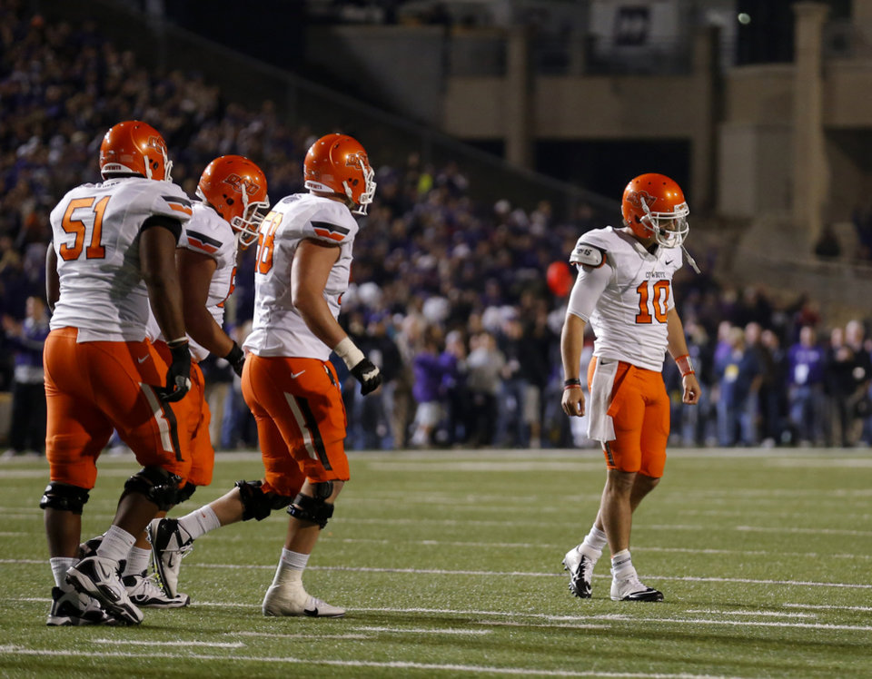 Oklahoma State\'s Clint Chelf (10) reacts after throwing an interception late in the fourth quarter of the college football game between Kansas State University (KSU) and Oklahoma State (OSU) at Bill Snyder Family Football Stadium in Manhattan, Kan., Saturday, Nov. 3, 2012. Photo by Sarah Phipps, The Oklahoman