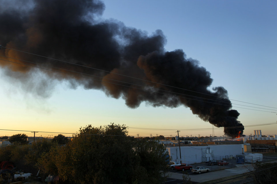 Smoke rises as firefighters let a chemical fire burn off at the Nexeo Solutions plant in Garland, Texas, on Friday, Nov. 16, 2012. Fire Capt. Merrill Balanciere says it's still unclear what caused the fire, but the flames were fueled by highly flammable toluene and methanol. All 41 workers who were at the plant at the time of the fire are safe. (AP Photo/The Dallas Morning News, Tom Fox) MANDATORY CREDIT; MAGS OUT; TV OUT; INTERNET OUT; AP MEMBERS ONLY