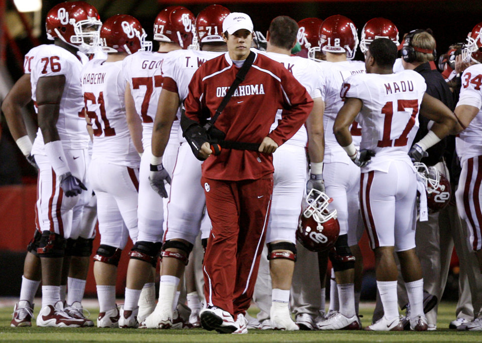 Oklahoma's Sam Bradford walks the sideline during the first half of the college football game between the University of Oklahoma Sooners (OU) and the University of Nebraska Cornhuskers (NU) on Saturday, Nov. 7, 2009, in Lincoln, Neb.