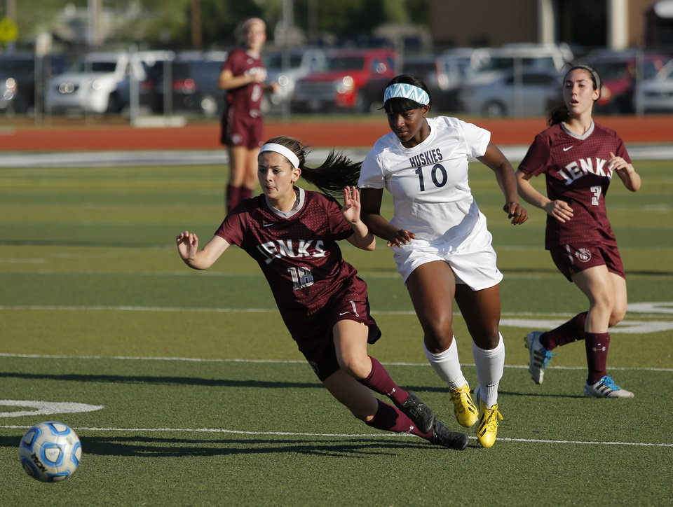 Edmond North's Courtney Dike (10) fights for the ball with Jenks' Meredith Carlson (18) and Riley Wilkins (2) during a high school soccer game between Edmond North and Jenks at Edmond North High School in Edmond, Okla., Tuesday, May 7, 2013.  Photo by Garett Fisbeck, For The Oklahoman