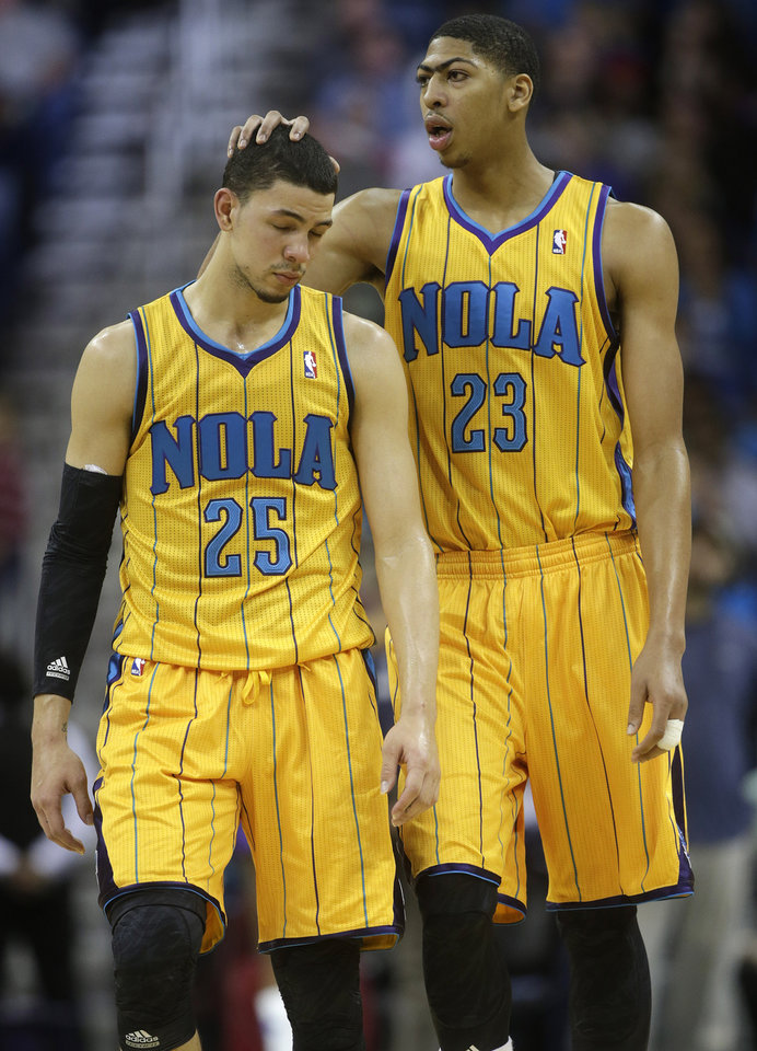 Photo - New Orleans power forward Anthony Davis (23) and shooting guard Austin Rivers (25) react during the fourth quarter of a loss to the Toronto Raptors in NBA basketball game at the New Orleans Arena in New Orleans, Friday, Dec. 28, 2012. (AP Photo/Dave Martin)