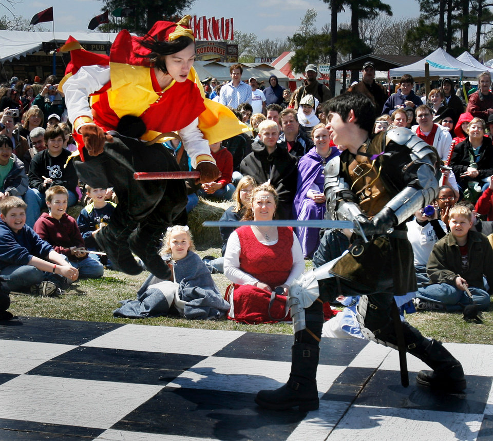 Knight and pawn battle on the human chess board on opening day of Medieval Fair at Reeves Park in Norman, Okla., Friday, April 4, 2008   BY STEVE SISNEY