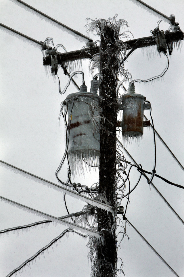 Photo - A power transformer in a residential neighborhood testifies to the amount of moisture that fell during a winter storm.  Most of the town was still without power on Friday, Jan. 29, 2010, in Purcell, Okla.  Photo by Steve Sisney, The Oklahoman