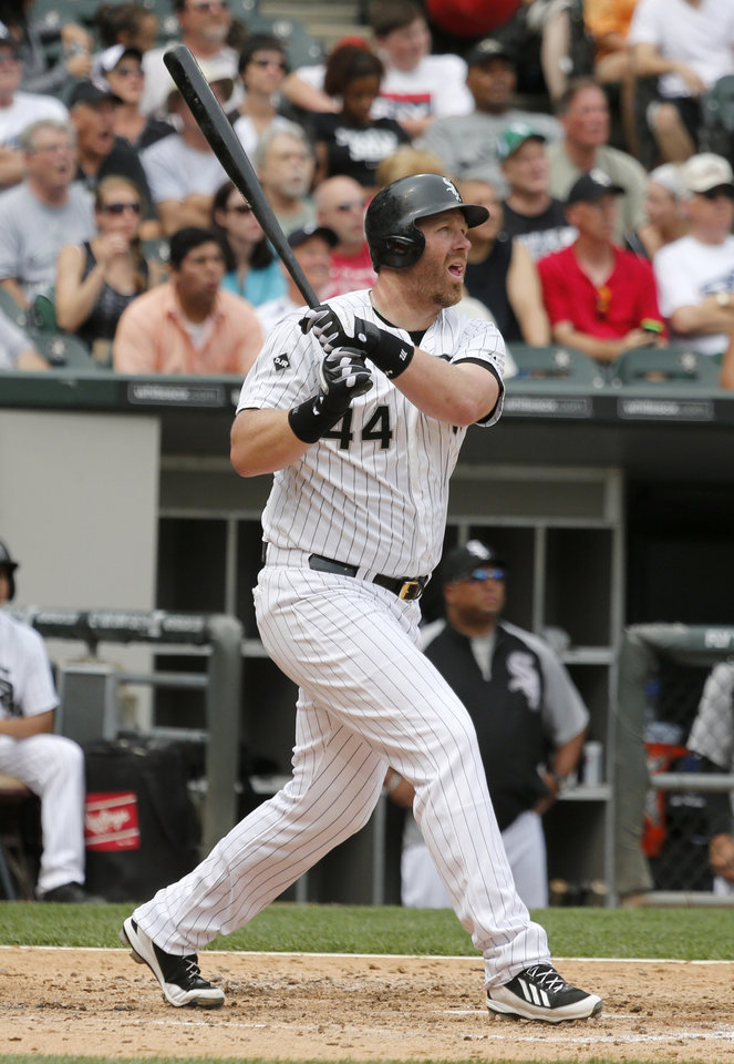 Photo - Chicago White Sox's Adam Dunn watches his three-run home run off San Francisco Giants starting pitcher Tim Hudson during the fifth inning of an interleague baseball game Wednesday, June 18, 2014, in Chicago. The White Sox's Jose Abreu and Conor Gillaspies scored on the hit. (AP Photo/Charles Rex Arbogast)