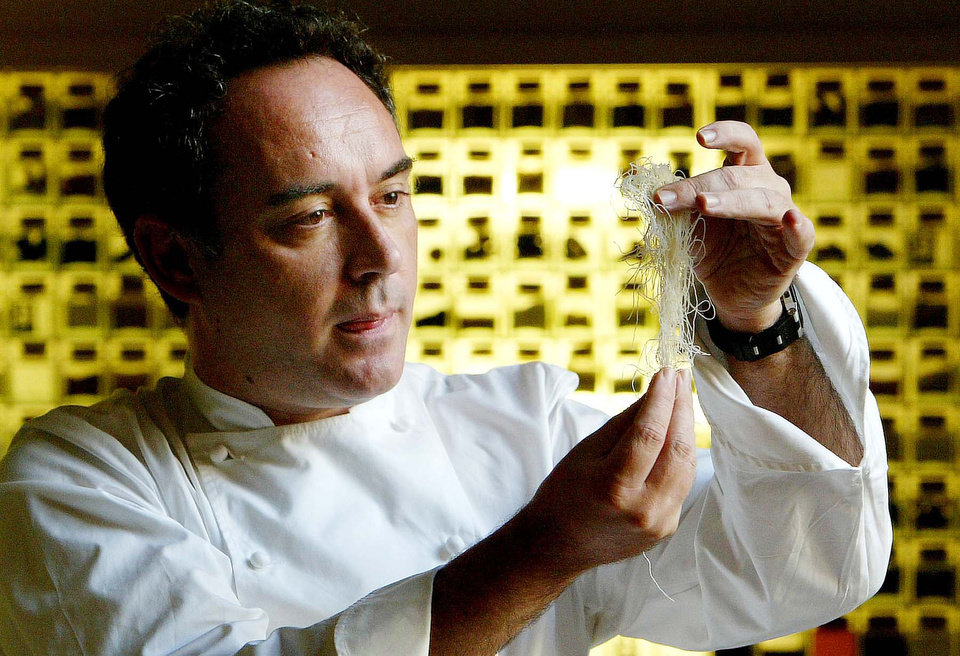 FILE - In this Dec. 5, 2003 file photo, Spanish chef Ferran Adria examines ingredients in his kitchen workshop in Barcelona, Spain. Spain's famous elBulli restaurant will temporarily reopen later this year as the renowned chef-owner Adria trains actors for a movie based on his iconic but shuttered eatery. Lucky gourmands will dine at the seaside Mediterranean landmark or in Hollywood if a decision is made to recreate the restaurant there.  (AP Photo/Bernat Armangue, File)