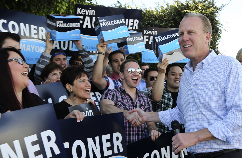 Photo - San Diego mayoral candidate Kevin Faulconer shakes hands with his supporters outside his campaign headquarterss Tuesday, Feb. 11, 2014, in San Diego. Faulconer is facing fellow city commissioner David Alvarez in the race to replace disgraced mayor Bob Filner.  (AP Photo/Lenny Ignelzi)