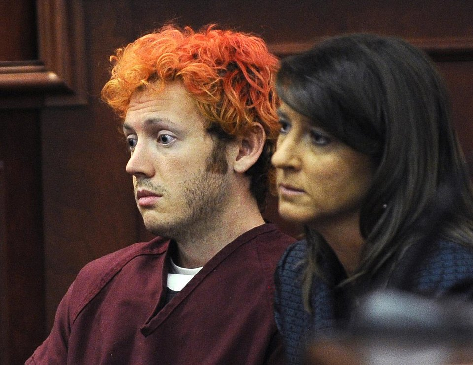 Photo -   FILE - In this Monday, July 23, 2012 file photo, James Holmes, accused of killing 12 people in Friday's shooting rampage in an Aurora, Colo., movie theater, appears in Arapahoe County District Court with defense attorney Tamara Brady in Centennial, Colo. A court hearing Thursday, Aug. 30, 2012 will examine Holmes' relationship with a University of Colorado psychiatrist to whom he mailed a package containing a notebook that reportedly contains violent descriptions of an attack. His attorneys say Holmes is mentally ill and that he sought help from psychiatrist Lynne Fenton at the school, where he was a Ph.D. student, until shortly before the July 20 shooting. Prosecutors allege Holmes may have been angry at the failure of a once promising academic career. (AP Photo/Denver Post, RJ Sangosti, Pool, File)