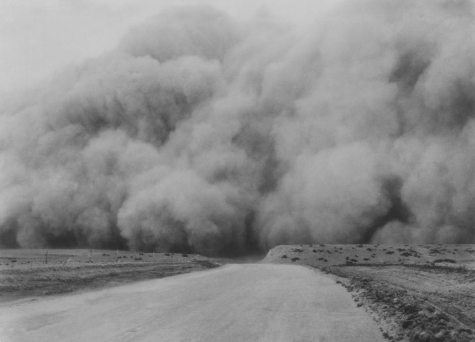 Photo -  DUST BOWL / DUST STORM:  The blackest and worst of the many dust storms of recent weeks was brought in on the rolling cloud that bore down on the Oklahoma panhandle and neighboring states late Sunday afternoon.  It was no darker in the cyclone cellar than it was outdoors during the storm, one farmer said.--(Associated Press wirephoto from Denver).   Published 4/15/1935 in The Oklahoma City Times.  Also published on 2/3/1980 in The Daily Oklahoman.