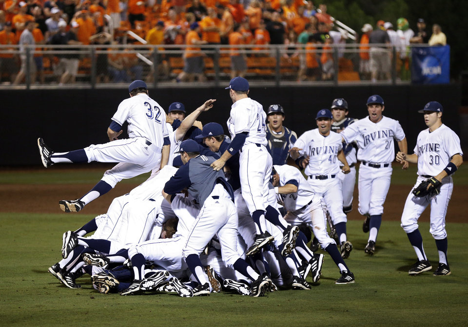 Photo - UC Irvine celebrates after winning Game 2 and the NCAA baseball Stillwater Super Regional between Oklahoma State and UC Irvine at Allie P. Reynolds Stadium in Stillwater, Okla., Saturday, June 7, 2014. Photo by Nate Billings, The Oklahoman