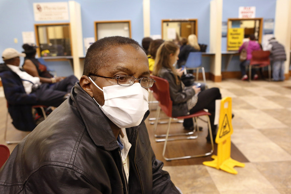 Walter Harris, Oklahoma City, wears a protective mask while sitting with several dozen other clients in the waiting room at the Oklahoma City/County Health Department Thursday afternoon, Jan. 10, 2013. Harris came for a flu shot and said he wore the mask to reduce the risk of catching germs while he was in the waiting area. Photo by Jim Beckel, The Oklahoman