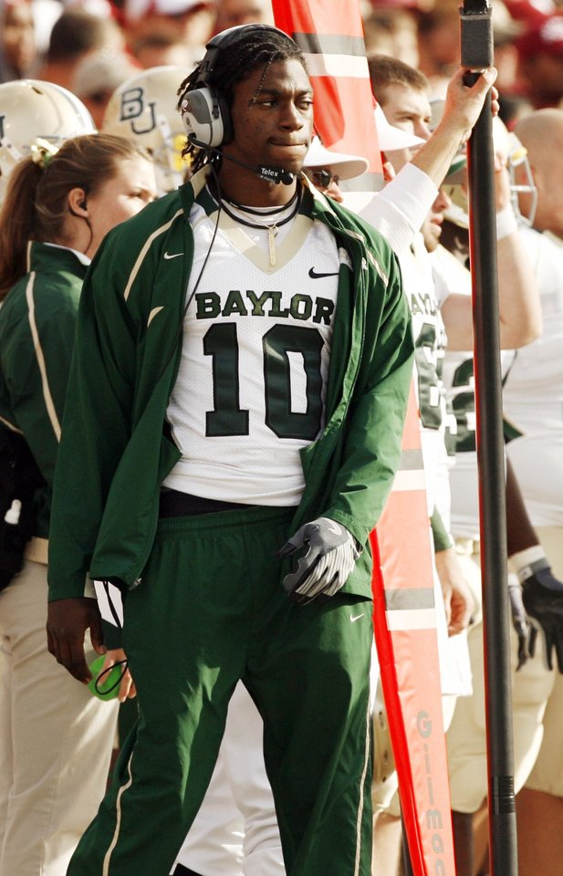 Photo - Injured Baylor Quarterback Robert Griffin III walks the sidelines during the second half of the college football game between The University of Oklahoma Sooners (OU) and the Baylor Bears at the Gaylord Family-Oklahoma Memeorial Stadium on Saturday, Oct. 10, 2009, in Norman, Okla.
