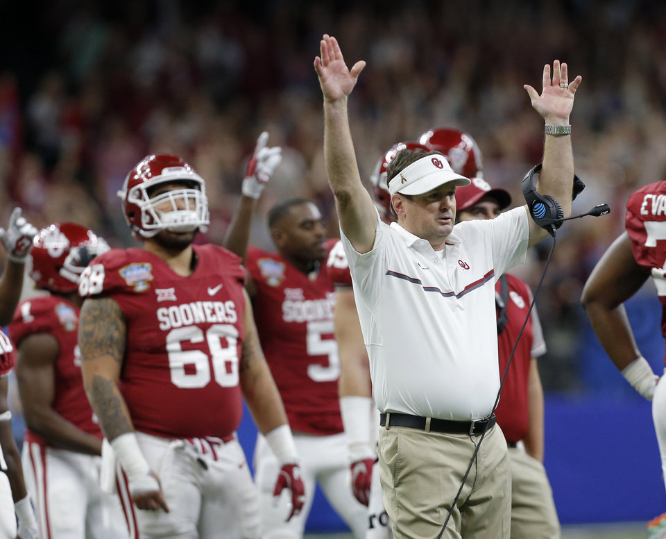 Photo - Bob Stoops celebrates an OU touchdown in the Sugar Bowl. (Photo by Sarah Phipps)