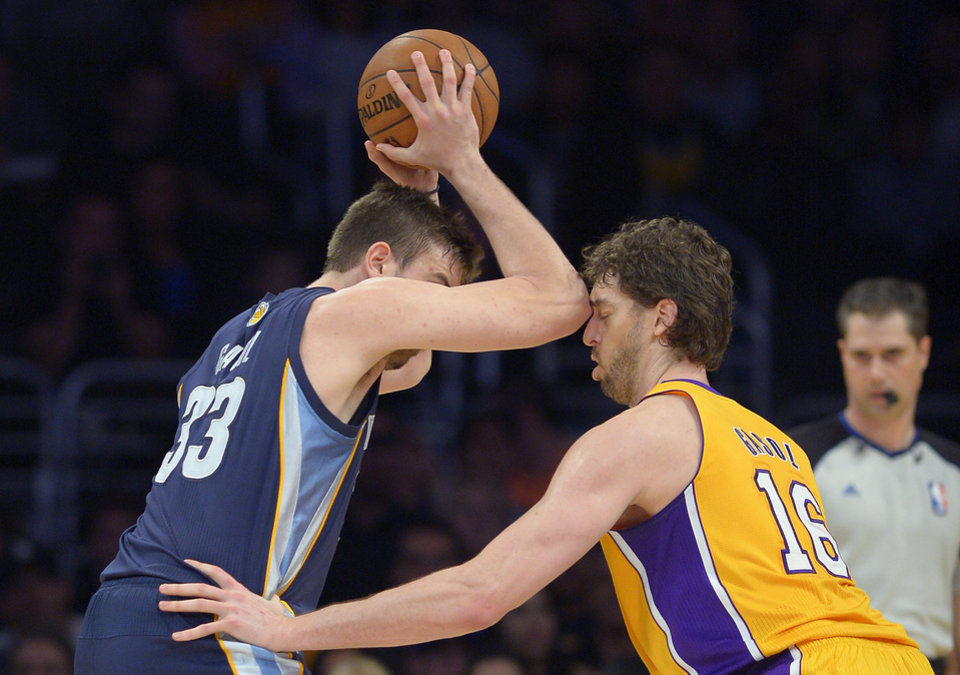 Memphis Grizzlies center Marc Gasol, left, of Spain, appears to make contact with the face of his brother Los Angeles Lakers forward Pau Gasol, during the first half of their NBA basketball game, Friday, April 5, 2013, in Los Angeles. Marc Gasol received a foul on the play and then a technical foul for adjuring the call.  (AP Photo/Mark J. Terrill)