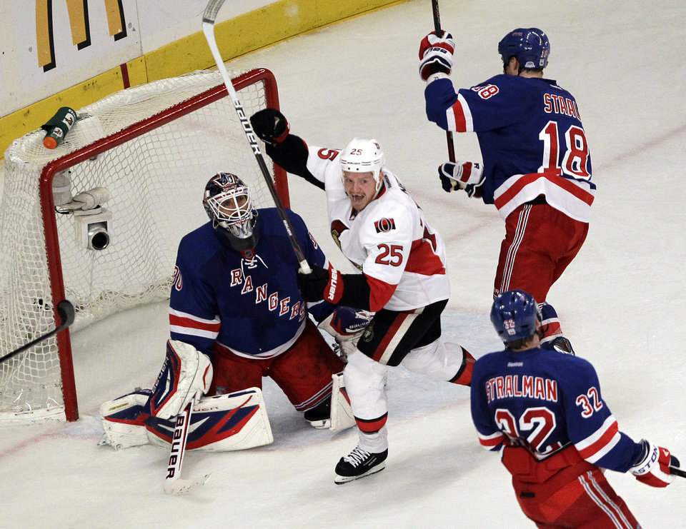 Photo -   Ottawa Senators' Chris Neil (25) celebrates a goal by teammate Daniel Alfredsson (not shown) during the second period of Game 7 of a first-round NHL hockey Stanley Cup playoff series against the New York Rangers, Thursday, April 26, 2012, in New York. (AP Photo/Julio Cortez)
