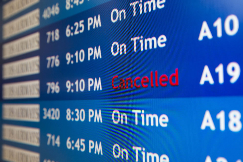 Photo - A departure board at the Philadelphia International Airport shows that US Airways Flight 796 to Tel Aviv has been canceled, Tuesday, July 22, 2014, in Philadelphia. The Federal Aviation Administration is telling U.S. airlines they are prohibited from flying to the Tel Aviv airport in Israel for 24 hours after a Hamas rocket exploded nearby. (AP Photo/Matt Rourke)