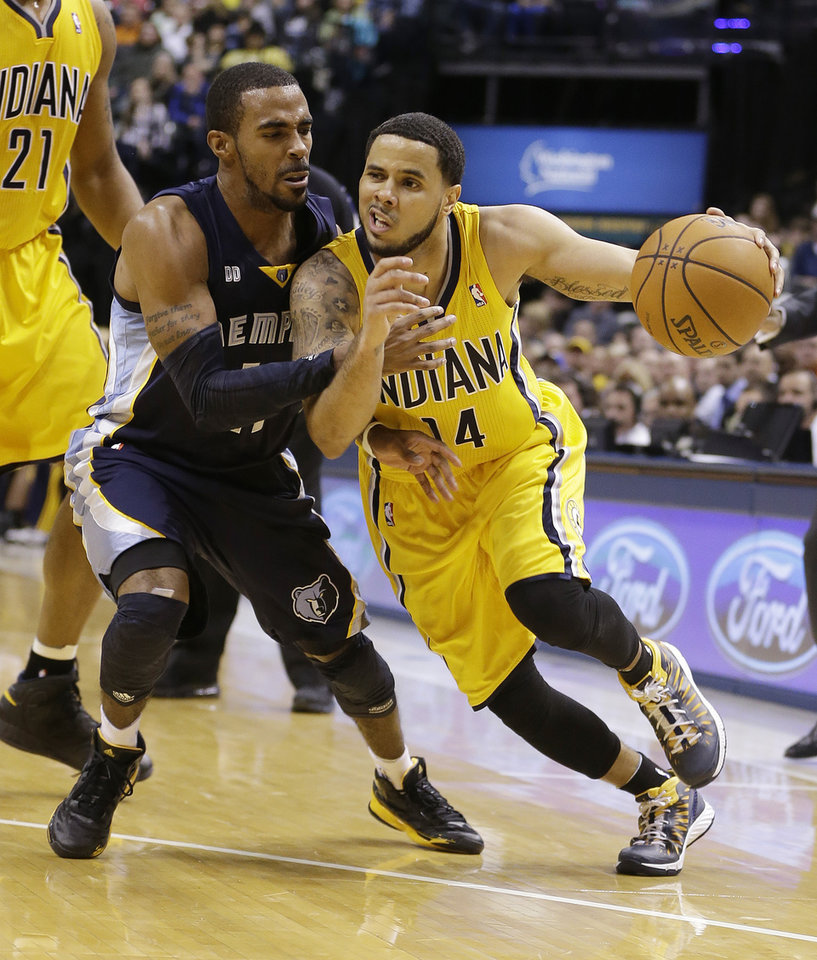 Indiana Pacers' D.J. Augustin (14) goes to the basket against Memphis Grizzlies' Mike Conley during the second half of an NBA basketball game Monday, Dec. 31, 2012, in Indianapolis. Indiana defeated Memphis 88-83. (AP Photo/Darron Cummings)
