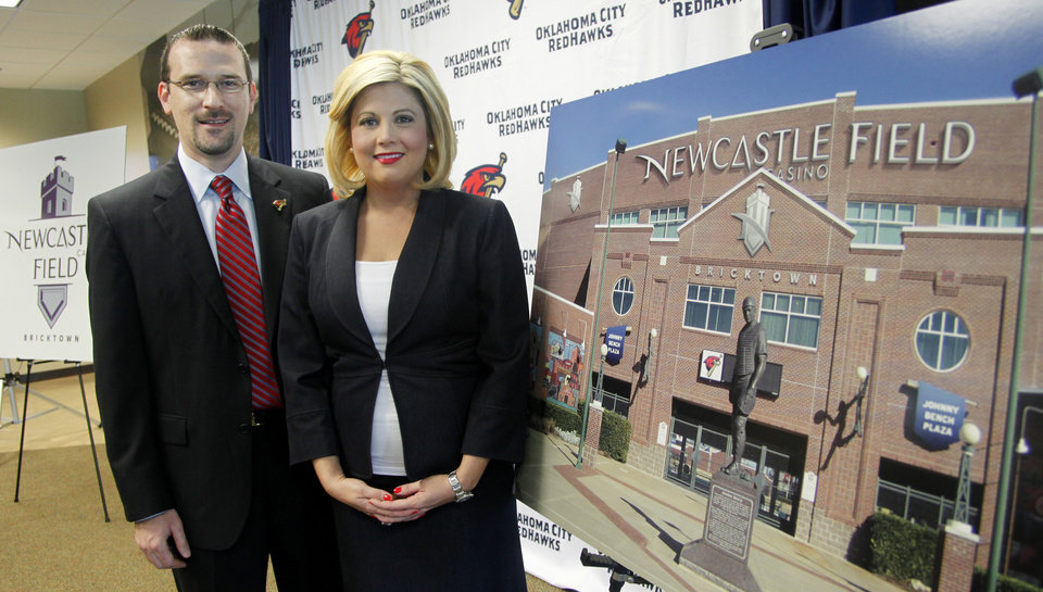 RedHawks President and General Manager Michael Byrnes and Newcastle Casino marketing manager Jennifer Cross stand next to a rendering of how the ballpark will look when the signage is complete during the press conference to announce the new name for the ballpark. Newcastle Field at Bricktown where the Redhawks will play their home games Wednesday, April 4, 2012. Photo by Doug Hoke, The Oklahoman