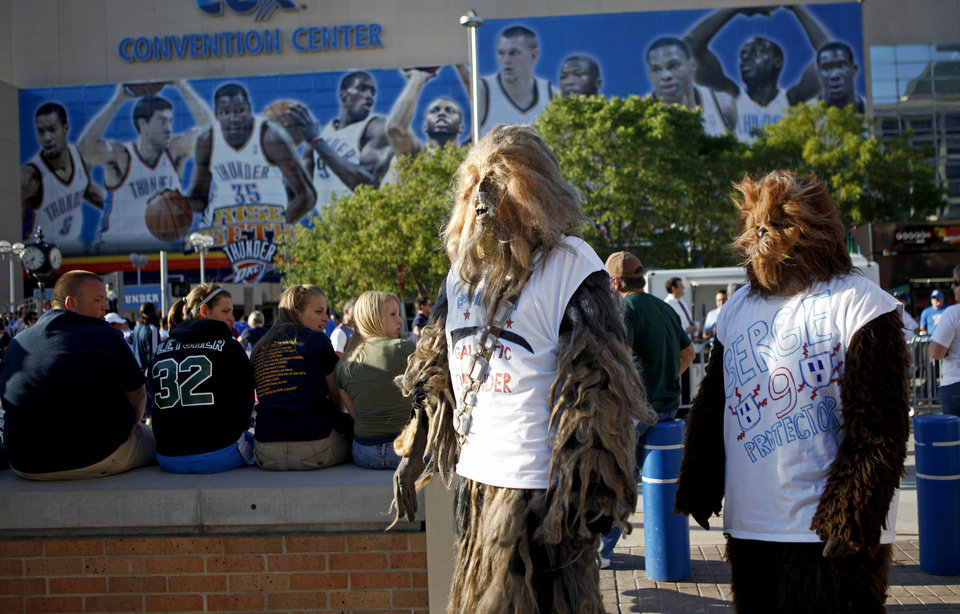 Photo - Doug Richardson, left, and Josh Pound of Midwest City walk towards the Oklahoma City Arena before game two of the Western Conference semifinals between the Memphis Grizzlies and the Oklahoma City Thunder in the NBA basketball playoffs at Oklahoma City Arena in Oklahoma City, Tuesday, May 3, 2011. Photo by Bryan Terry, The Oklahoman