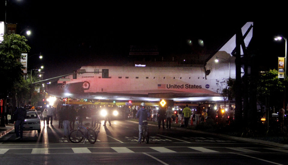 The space shuttle Endeavour leaves Los Angeles International Airport hangar onto the streets in Los Angeles on Friday, Oct. 12, 2012. Endeavour's 12-mile road trip kicked off shortly before midnight Thursday as it moved from its Los Angeles International Airport hangar en route to the California Science Center, its ultimate destination, said Benjamin Scheier of the center. (AP Photo/Los Angeles Times, Lawrence K. Ho)