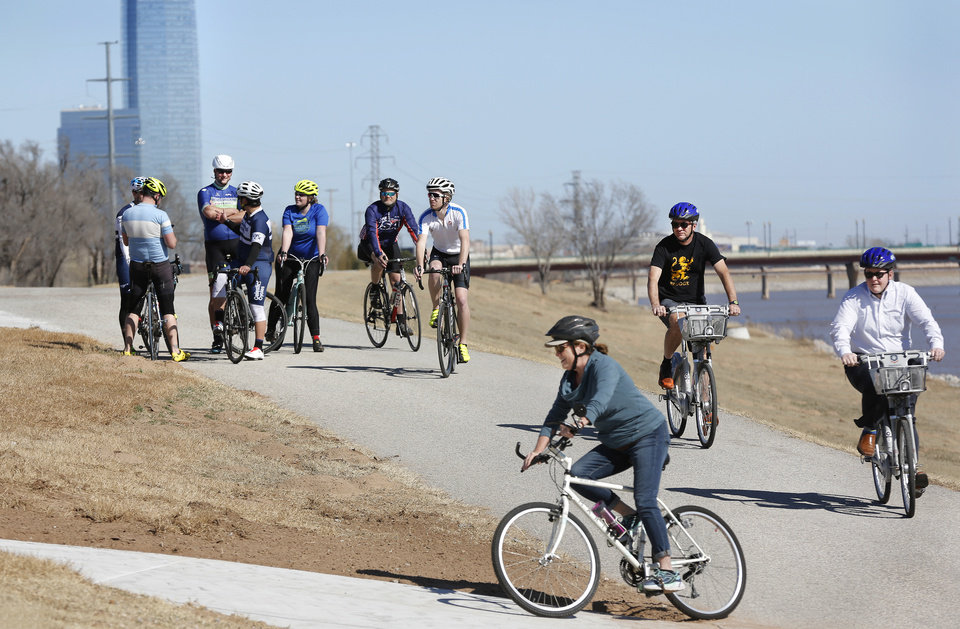Photo - The Devon Tower sits in the background as cyclists travel along the newly completed Will Rogers Trail. [PHOTO BY JIM BECKEL, THE OKLAHOMAN]