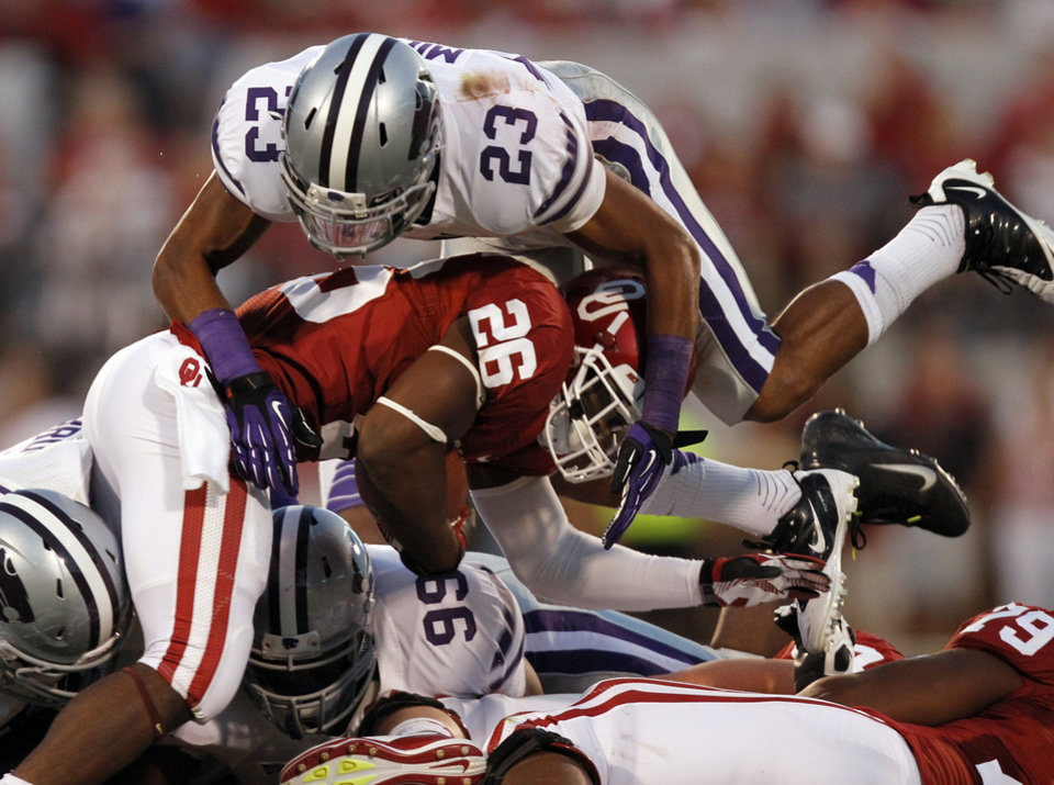 Kansas State\'s Jarard Milo (23) brings down Oklahoma\'s Damien Williams (26) during the college football game between the University of Oklahoma Sooners (OU) and the Kansas State University Wildcats (KSU) at the Gaylord Family-Memorial Stadium on Saturday, Sept. 22, 2012, in Norman, Okla. Photo by Chris Landsberger, The Oklahoman