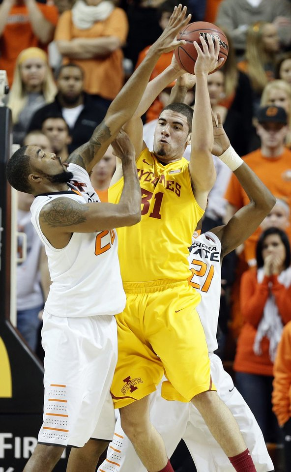 Oklahoma State Cowboys' Michael Cobbins (20) defends on Iowa State Cyclones' Georges Niang (31) during the college basketball game between the Oklahoma State University Cowboys (OSU) and the Iowa State University Cyclones (ISU) at Gallagher-Iba Arena on Wednesday, Jan. 30, 2013, in Stillwater, Okla.  Photo by Chris Landsberger, The Oklahoman